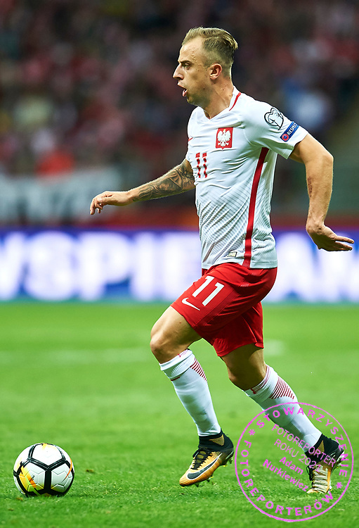 Warsaw, Poland - 2017 September 04: Kamil Grosicki from Poland controls the ball during soccer match Poland v Kazakhstan - FIFA 2018 World Cup Qualifier at PGE National Stadium on September 04, 2017 in Warsaw, Poland.<br /> <br /> Adam Nurkiewicz declares that he has no rights to the image of people at the photographs of his authorship.<br /> <br /> Picture also available in RAW (NEF) or TIFF format on special request.<br /> <br /> Any editorial, commercial or promotional use requires written permission from the author of image.<br /> <br /> Mandatory credit:<br /> Photo by &copy; Adam Nurkiewicz / Mediasport