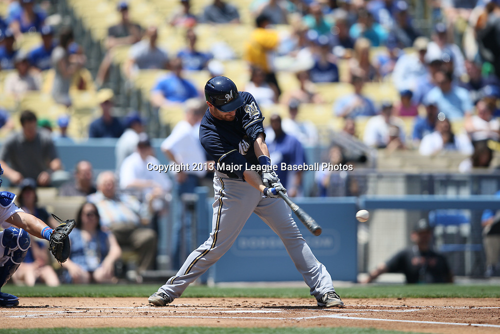 LOS ANGELES, CA - APRIL 28:  Jonathan Lucroy #20 of the Milwaukee Brewers hits into a double play that ends a scoring threat in the top of the first inning during the game against the Los Angeles Dodgers on Sunday, April 28, 2013 at Dodger Stadium in Los Angeles, California. The Dodgers won the game 2-0. (Photo by Paul Spinelli/MLB Photos via Getty Images) *** Local Caption *** Jonathan Lucroy