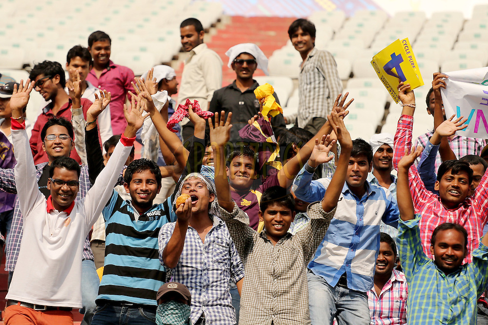 Crowd enjoying the atmosphere during the first semi final match of the Oppo Champions League Twenty20 between the Kolkata Knight Riders and the Hobart Hurricanes held at the Rajiv Gandhi Cricket Stadium, Hyderabad, India on the 2nd October 2014. Photo by:  Jacques Rossouw / Sportzpics/ CLT20<br /> <br /> <br /> Image use is subject to the terms and conditions as laid out by the BCCI/ CLT20.  The terms and conditions can be downloaded here:<br /> <br /> http://sportzpics.photoshelter.com/gallery/CLT20-Image-Terms-and-Conditions-2014/G0000IfNJn535VPU/C0000QhhKadWcjYs