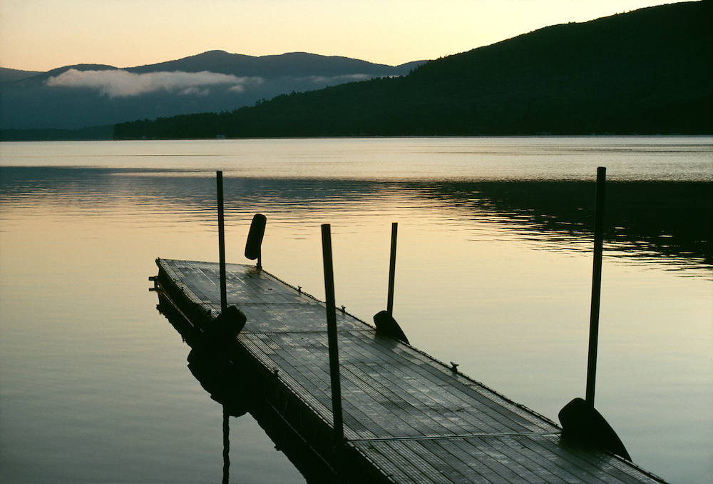 New York, Adirondacks, Lake George, dock at dusk.
