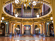 "16 MARCH 2020 - DES MOINES, IOWA: The empty rotunda in the State Capitol in Des Moines. Because of numerous reports of Coronavirus in Iowa, the governor is suspending the legislative session for 30 days. It was scheduled to run until mid-April. Sunday night, the Governor announced that the state health department had recorded ""community spread"" in Des Moines. As a result the State Capitol instituted mitigation measures that included mandatory health screening for everyone going into the building, canceling group tours of the building, and closing the souvenir shop and snack bar.    PHOTO BY JACK KURTZ"