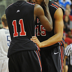 Rutgers Scarlet Knights guard/forward Dane Miller (11) motivates guard/forward Derrick Randall (15) after Randall missed a slam dunk during Rutgers' 67-60 upset victory over #8 UConn in NCAA Big East Basketball action at the Louis Brown Athletic Center in Piscataway, N.J. on Jan 7, 2012.