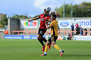 Aaron Wildig of Morecambe beats Padraig Amond of Newport County to the ball during the EFL Sky Bet League 2 match between Morecambe and Newport County at the Globe Arena, Morecambe, England on 16 September 2017. Photo by Mick Haynes.