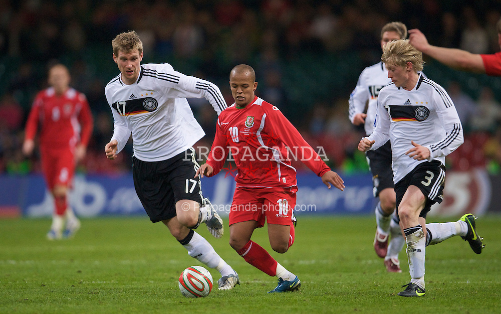 CARDIFF, WALES - Wednesday, April 1, 2009: Wales' Robert Earnshaw and Germany's Per Mertesacker during the 2010 FIFA World Cup Qualifying Group 4 match at the Millennium Stadium. (Pic by David Rawcliffe/Propaganda)