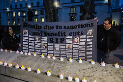 London, UK. 15th March, 2019. Campaigners against homelessness from groups including Streets Kitchen and Disabled People Against Cuts (DPAC) hold a vigil opposite Downing Street to commemorate 799 homeless people who have died over the last 18 months and to call for an end to the cuts to services which result in homelessness and the increasing criminalisation of those experiencing homelessness. Candles honour the dead.