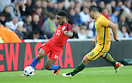 Raheem Sterling (l) of England and Bailey Wright of Australia during the International Friendly match at the Stadium Of Light, Sunderland<br /> Picture by Simon Moore/Focus Images Ltd 07807 671782<br /> 27/05/2016