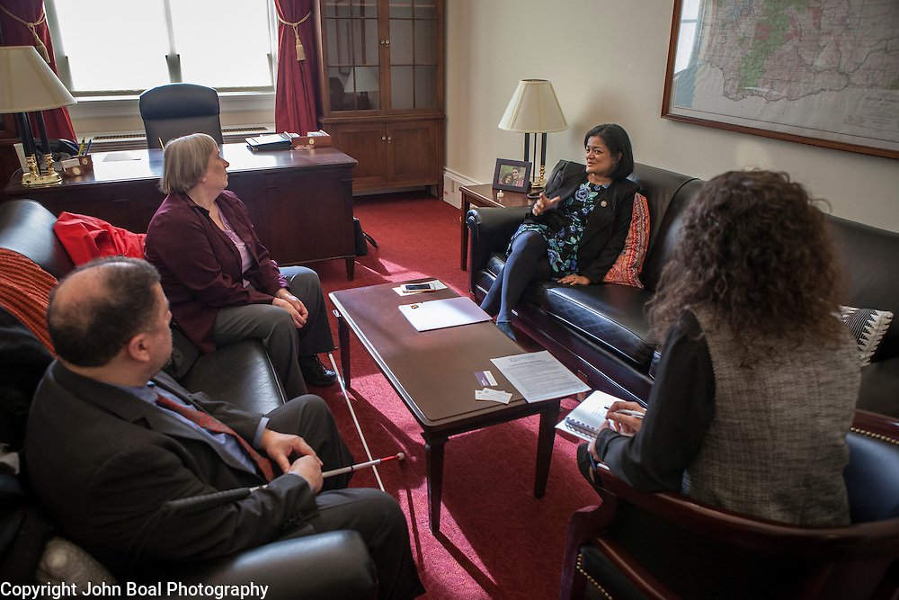 Representative Pramila Jayapal (D-WA, 7), and Danielle Fulfs, her Legislative Assistant, right, meet with representatives, -- and -- of the National Federation of the Blind, on Tuesday, January 31, 2017.  John Boal photo/for The Stranger