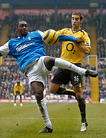 Photo: Glyn Thomas.<br />Birmingham City v Arsenal. The Barclays Premiership. 04/02/2006.<br />Birmingham's Emile Heskey (L) shoots under pressure from Mathieu Flamini.