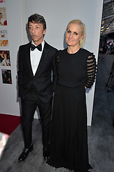 PIERPAOLO PICCIOLI and MARIA GRAZIA CHIURI at British Vogue's Centenary Gala Dinner in Kensington Gardens, London on 23rd May 2016.