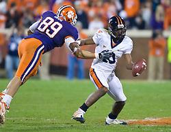November 21, 2009; Clemson, SC, USA;  Clemson Tigers defensive tackle Miguel Chavis (89) puts pressure on Virginia Cavaliers quarterback Jameel Sewell (10) during the fourth quarter at Memorial Stadium.  Clemson defeated Virginia 34-21.