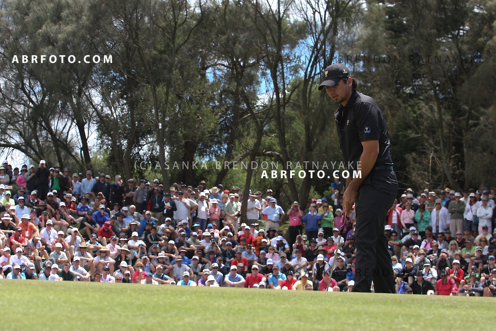 20 November 2011 : Jason Day practices his putt in front of a large gallery during the fifth-round Sunday Final round single ball matches at the Presidents Cup at the Royal Melbourne Golf Club in Melbourne, Australia. .