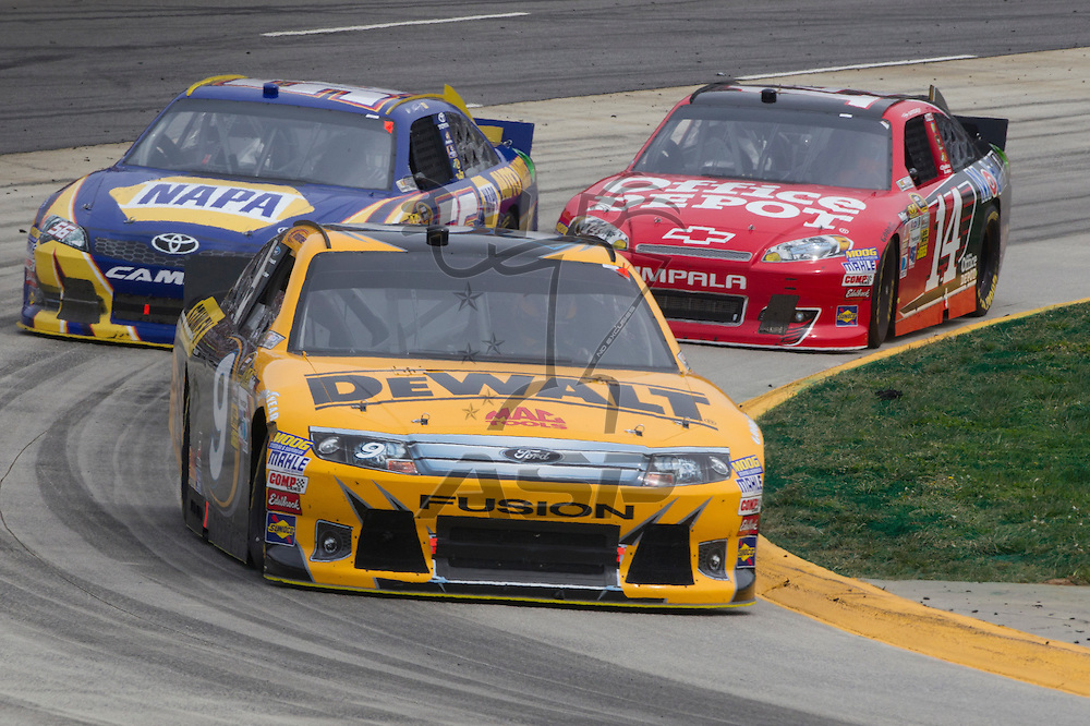 Martinsville, VA - MAR 01, 2012:  Marcos Ambrose (9) races for position during the Goody's Fast Relief 500 race at the Martinsville Speedway in Martinsville, VA.