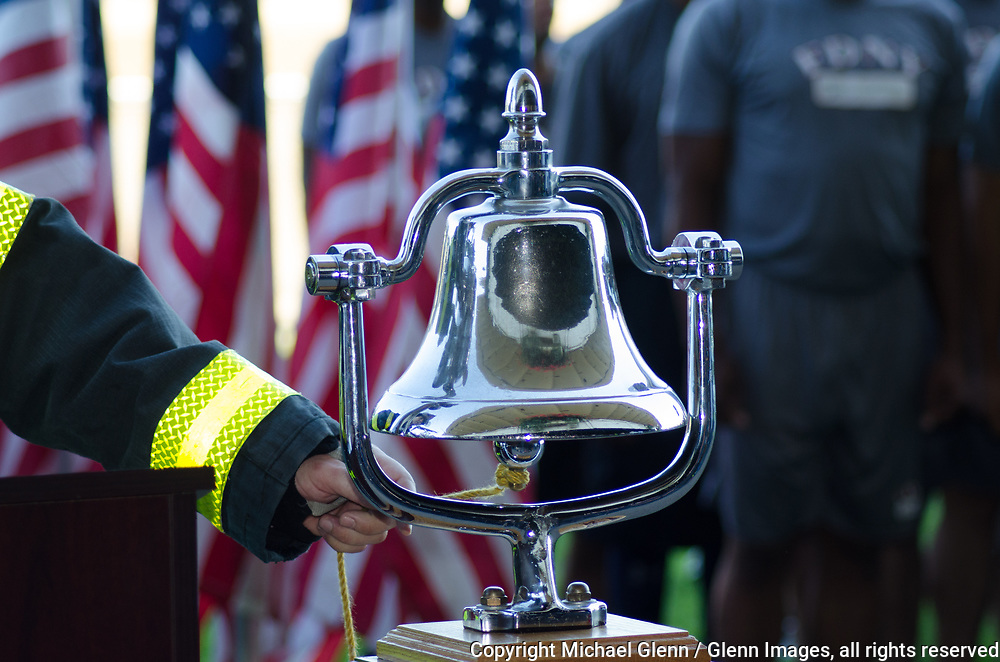 1 Oct 2017 Elmont, New York United States of America // Participants read off the name of the fallen they climbed in memory of, and ring the bell, at the end of the 3RD annual national stair climb for fallen firefighters at the Belmont Park racetrack  Michael Glenn  /   for the FDNY
