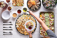 A Catering food photography session for a regional restaurant group. From the subway tile background to the styled dish in hand, every element was carefully considered on set.