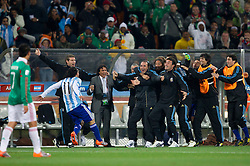 Carlos Tevez of Argentina celebrates with his teammates after he scored second time during the 2010 FIFA World Cup South Africa Round of Sixteen match between Argentina and Mexico at Soccer City Stadium on June 27, 2010 in Johannesburg, South Africa. (Photo by Vid Ponikvar / Sportida)