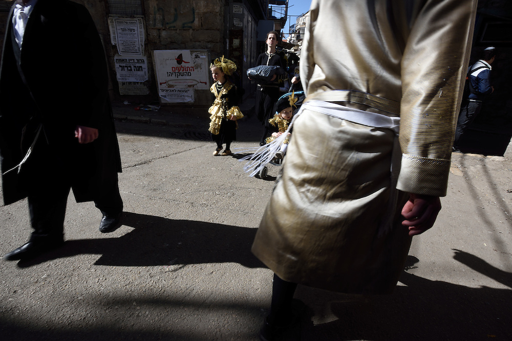 A Jewish girl, waering costume, walks during Purim Holiday in the Ultra-Orthodox Jewish neighbourhood of Mea Shearim in Jerusalem, on March 6, 2015. The Jewish holiday of Purim commemorates the salvation of the Jews living with in the borders of the ancient Persian Empire. Purim customs include food gifts, charity, wearing costumes and drinking heavily.