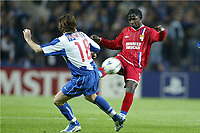 FOOTBALL - CHAMPIONS LEAGUE CUP 2003/04 - 1/4 FINAL 1ST LEG - 23/03/2004 - FC PORTO v OLYMPIQUE LYONNAIS - MAHAMADOU DIARRA (LYON) / MANICHE (POR) - PHOTO JEAN MARIE HERVIO / DIGITALSPORT