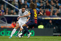 30.01.2013 SPAIN -  Copa del Rey 12/13 Matchday 1/4  match played between Real Madrid CF vs  F.C. Barcelona (1-1) at Santiago Bernabeu stadium. The picture show Mesut Ozil (German midfielder of Real Madrid) and Carles Puyol Saforcada (Spanish defender of Barcelona)