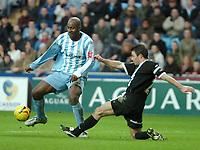 Photo: Ed Godden.<br />Coventry City v Derby County. Coca Cola Championship. 21/01/2006. <br />Derby's Jeff Kenna tackles Stern John (L).