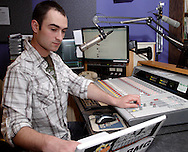 Sean Martin on the air at WWSU-FM, the Wright State University radio station, Monday, May 2, 2011.  Martin is also the general manager at WWSU.