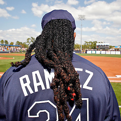 February 26, 2011; Port Charlotte, FL, USA; Tampa Bay Rays left fielder Manny Ramirez (24) stands during a moment of silence honoring fallen St. Petersberg Police officer Carl Crawford during a spring training exhibition game against the Pittsburgh Pirates at Charlotte Sports Park.  Mandatory Credit: Derick E. Hingle