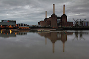 Battersea Power Station perfectly reflected in a mirror-like River Thames on a grey January morning, just before the river boat came along and broke the mirror