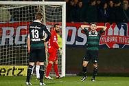 26-01-2016 VOETBAL:WILLEM II-FC GRONINGEN:TILBURG<br /> <br /> Bryan Linssen van FC Groningen teleurgesteld na missen van een enorme kans. Kostas Lamprou van Willem II kijkt toe<br /> <br /> Foto: Geert van Erven