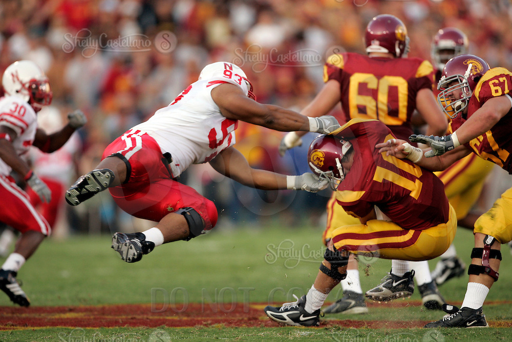 16 September 2006: #93 Ndamukong Suh flys through the air tacking #10 John David Booty starting quarterback in action during  the USC Trojans college football home opener against the Nebraska Cornhuskers with a 28-10 win over the Big-12 team at the Los Angeles Memorial Coliseum in CA.