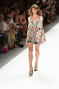 Print dress with lace vest. By Custo Barcelona at the Spring 2013 Fashion Week show in New York.