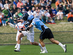 Johns Hopkins midfielder Paul Rabil (9) butts helmets with Virginia defenseman Ryan Nizolek (24).  The #2 ranked Virginia Cavaliers defeated the #6 ranked Johns Hopkins Blue Jays 13-12 in overtime at the University of Virginia's Klockner Stadium in Charlottesville, VA on March 22, 2008.  The loss, in front of a record UVA crowd of 7,500, was the third consecutive overtime defeat for Hopkins, the defending national champions.