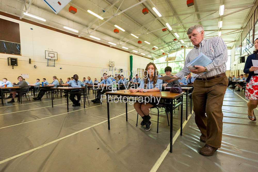 5/6/2012<br /> Aeneas Daly exam superintendent pictured handing out papers for the Junior Cert English exam at Kilkenny College yesterday. <br /> Also in the picture near is student Milly Farrell Kelly aged 15 from Thomastown Co. Kilkenny.<br /> Picture Dylan Vaughan.