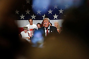 Republican presidential candidate Donald Trump speaks during a campaign event in Phoenix, Arizona July 11, 2015. Trump has lost business relationships in recent weeks after saying that many undocumented immigrants in the United States are criminals.  REUTERS/Nancy Wiechec