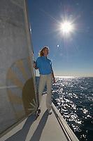 Female sailor on yacht in ocean