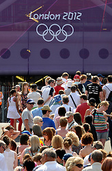 © Licensed to London News Pictures. 25/07/2012. Cardiff, Wales, UK.  Spectators queue for the first event of the 2012 Olympics, the womens football match between Great Britain and New Zealand at the Millennium Stadium in Cardiff. 25 July 2012..Photo credit : Simon Chapman/LNP