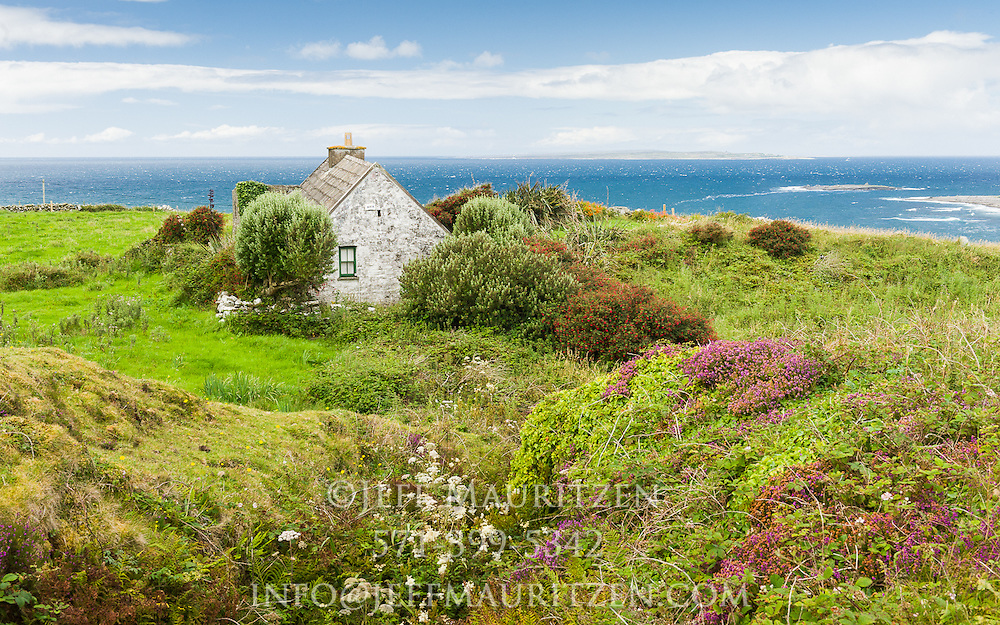 Image of a scenic Irish cottage on the ocean.