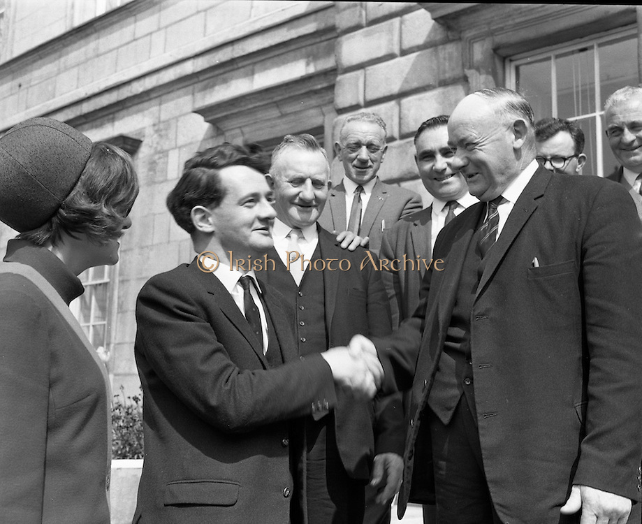 Newly elected Deputy Desmond O&rsquo;Malley, and his wife, Pat, being welcomed at Dail Eireann by Deputy Paddy Clohessy, Senator Patrick Ryan, and some friends from his East Limerick constituency. <br /> 28.05.1968