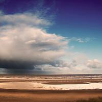 View across the sands towards the sea at Holkham beach in north Norfolk, England