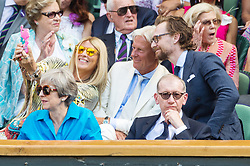 © Licensed to London News Pictures. 15/07/2018. London, UK. Patricia Borg, Borg and Tom Hiddleston taker a camera phone selfie in the royal box centre on court tennis on the 13th day of the Wimbledon Tennis Championships 2018 held at the All England Lawn Tennis and Croquet Club. Photo credit: Ray Tang/LNP