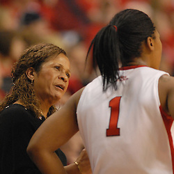 Jan 31, 2009; Piscataway, NJ, USA; Rutgers head coach speaks with guard Khadijah Rushdan (1) during the second half of South Florida's 59-56 victory over Rutgers in NCAA women's college basketball at the Louis Brown Athletic Center