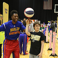 Libby Ezell | BUY AT PHOTOS.DJOURNAL.COM<br /> Dragon from the Globetrotters was excited for Brodie Cole, 10, learning how to spin a ball on his finger