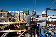 "Greensburg, Kansas, USA..Construction of the Kiowa County Commons. This new community learning center will include a museum,  library and media center. It is projected to be one of the many LEED Platinum buildings in Greensburg, and includes the proposed sustainable elements:.o Abundance of light streaming into the building through the extensive glass facing the north;.o Photovoltaic panels on the roof (north side above museum) to provide electrical power from solar generation;.o The pair of wind turbines also supplies electrical power;.o Numerous light monitors in the garden area roof allowing sunlight to filter into the facility from above;.o Extensive use of awnings, overhang of the roofline and trees to control the amount of light/heat let in;.o Trellis on the roof to provide shading;.o Abundance of windows on the east wall to allow morning light into various areas;.o Use of wall construction similar to that of the Business Incubator building, which carries an R-22 insulating factor....""Greensburg: Better, Stronger, Greener!"".On May 4, 2007, an EF5 tornado cut a 1.7-mile path of destruction through Greensburg, Kansas. Winds reaching speeds of 205 miles per hour uprooted trees, demolished homes and leveled the town. Eleven people died and 95% of the buildings were destroyed beyond repair. Residents have since worked furiously to rebuild it in a way that is both economically and environmentally sustainable and to meet the highest environmental standards. Greensburg, whose population has dropped from about 1400 to 800 following the storm and is now growing again, is currently the greenest town in America and the first in the United States to pass a resolution to certify that all city-owned buildings earn LEED Platinum accreditation, the highest level of the LEED rating system...Foto © Stefan Falke"