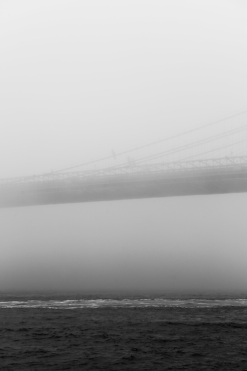 Brooklyn Bridge in fog, Brooklyn, NY, US