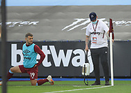 Jack Wilshere of West Ham Unitedlooks on as the corner flag is disinfected during the Premier League match at the London Stadium, London. Picture date: 20th June 2020. Picture credit should read: David Klein/Sportimage