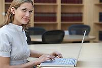 Office worker using laptop in legal office portrait