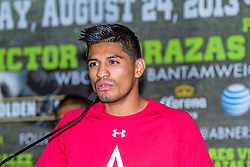 CARSON, California/USA (Thursday, Aug 22 2013) - Three-Time and Three-Division World Champion Abner Mares (26-0-1, 14 KO's), of Hawaiian Gardens, addresses the media during the last Mares vs Gonzalez press conference at The SubHub Center in Carson, CA.  PHOTO © Eduardo E. Silva/SILVEXPHOTO.COM.