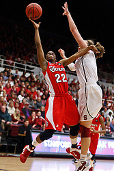 March 21, 2011; Stanford, CA, USA; St. John's Red Storm guard Eugeneia McPherson (22) shoots past Stanford Cardinal forward Kayla Pedersen (14) during the first half of the second round of the 2011 NCAA women's basketball tournament at Maples Pavilion.
