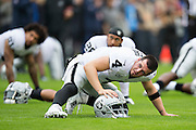 NASHVILLE, TN - NOVEMBER 29:  Derek Carr #4 of the Oakland Raiders warming up before a game against the Tennessee Titans at Nissan Stadium on November 29, 2015 in Nashville, Tennessee.  The Raiders defeated the Titans 24-21.  (Photo by Wesley Hitt/Getty Images) *** Local Caption *** Derek Carr