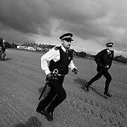 Police are trying to keep up with activists who are heading across the fields to avoid police stopping them...Crude Oil Awakening is a coalition of climate change activist groups. On Saturday Oct 16 they shut the only entrance to Coryton oil refinery in Essex, UK with the aim of highlighting the issues of climate change and the burning of fossil fuels. The blockade meant that a great number of trucks with oil were not able to leave the refinary during the day of action.