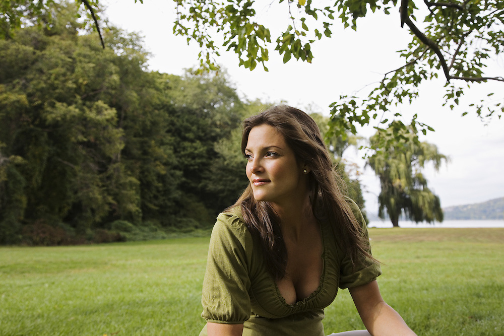 Portrait of pregnant woman in green park