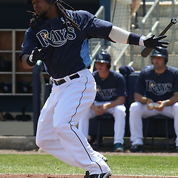 March 15, 2011; Port Charlotte, FL, USA; Tampa Bay Rays designated hitter Manny Ramirez (24) hits a one run single during a spring training exhibition game against the Florida Marlins at Charlotte Sports Park.   Mandatory Credit: Derick E. Hingle